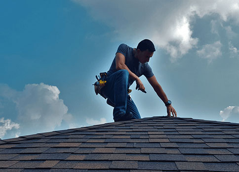 Insurance specialist inspecting roof